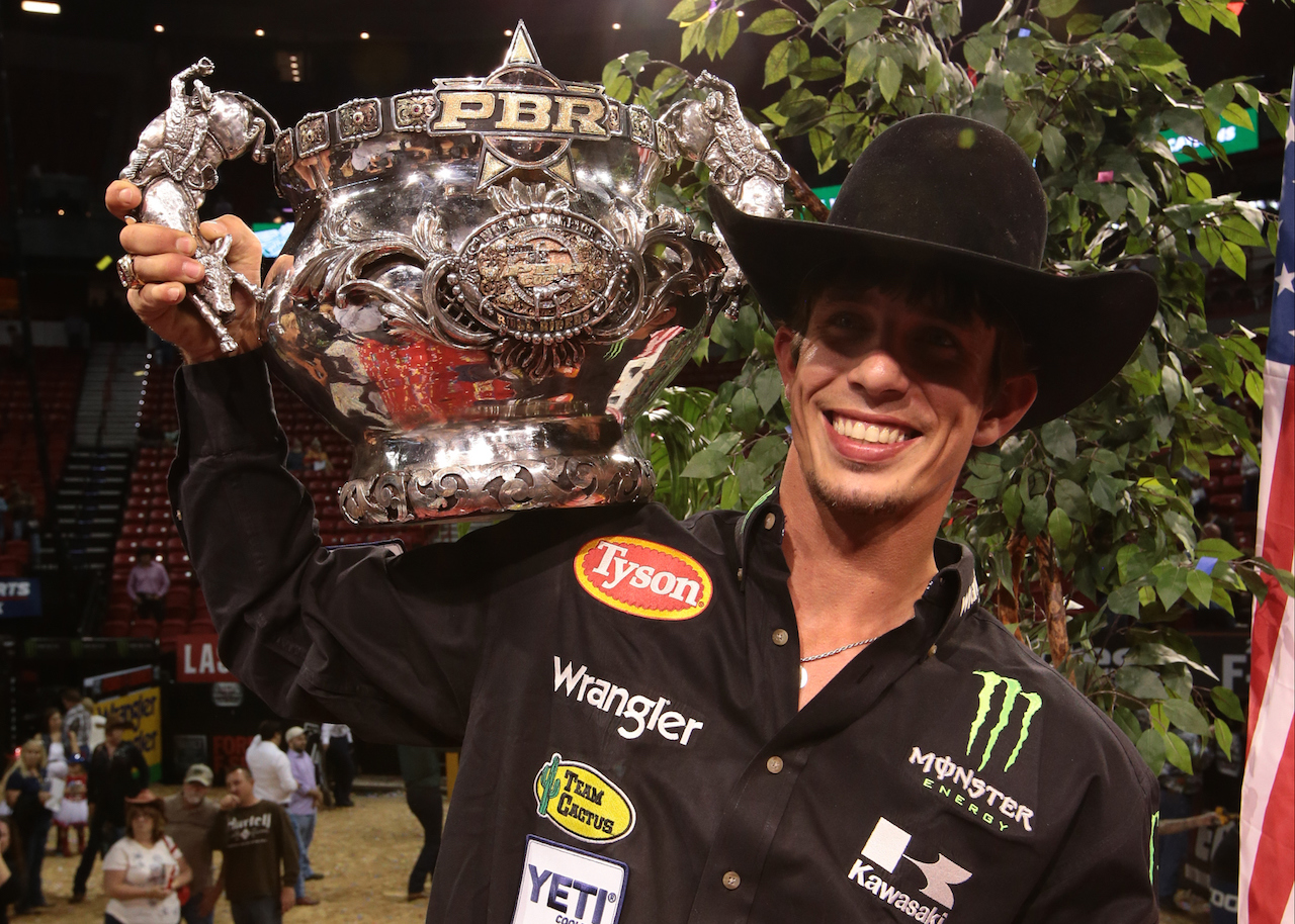 PHOTO - JB WITH CUP 2015 PBR WORLD CHAMPION