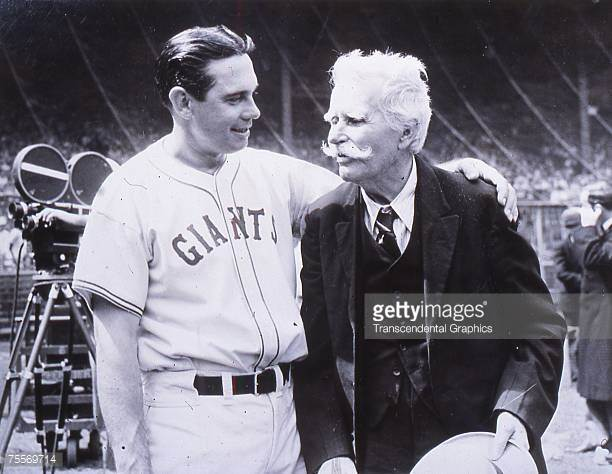 New York Giants Manager Bill Terry and Jim Murtie who gave the team its name celebrating the team's 50th anniversary in 1933.