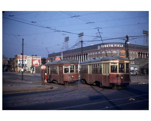 A pair of trolley cars passing Ebbets Field in 1950's