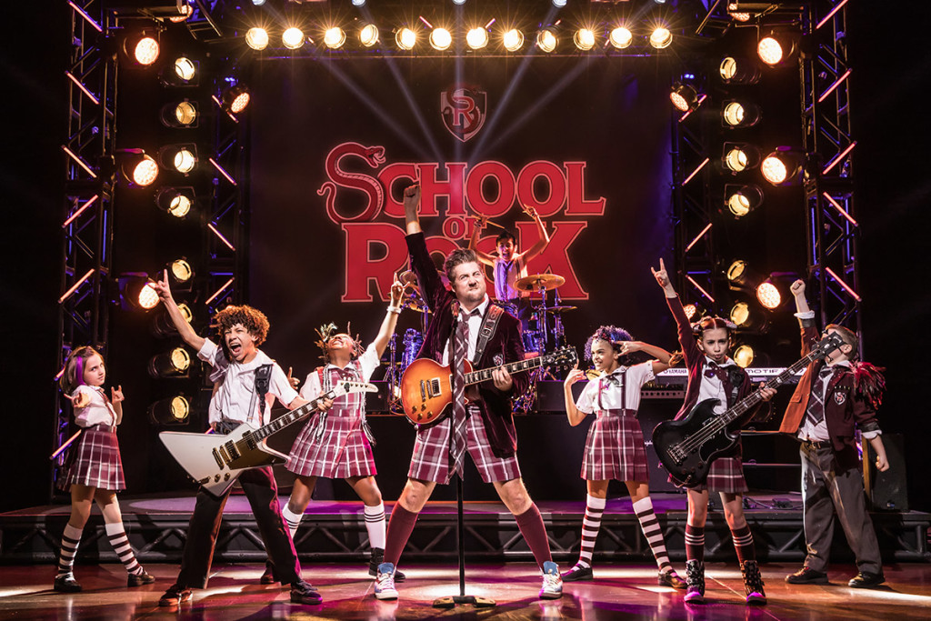 eric-petersen-and-cast-in-school-of-rock-the-musical